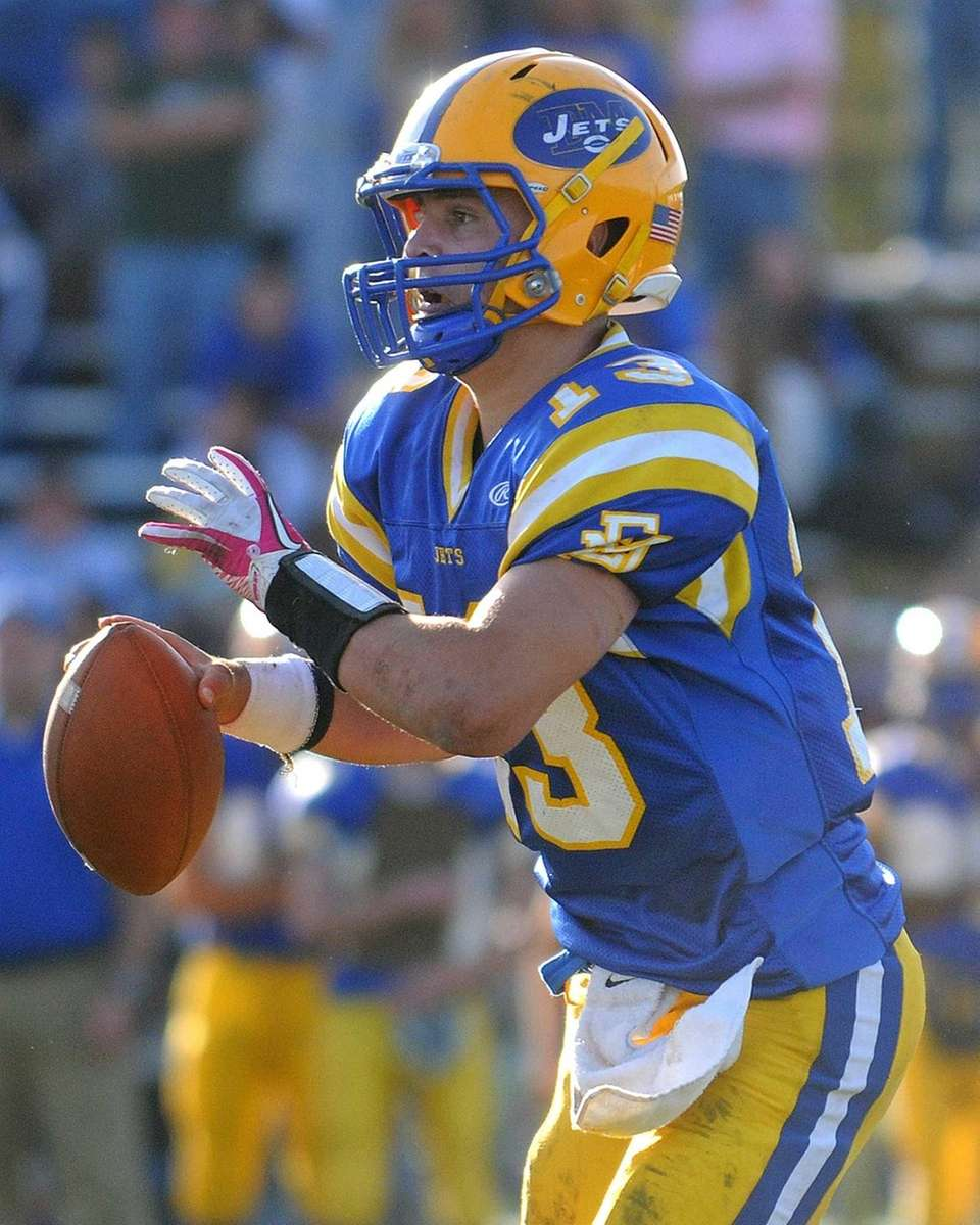 East Meadow quarterback Chris Buschi looks for an
