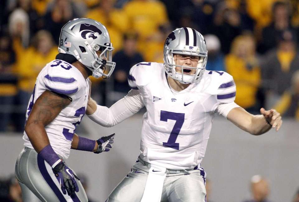 Kansas State's Collin Klein directs the offense during