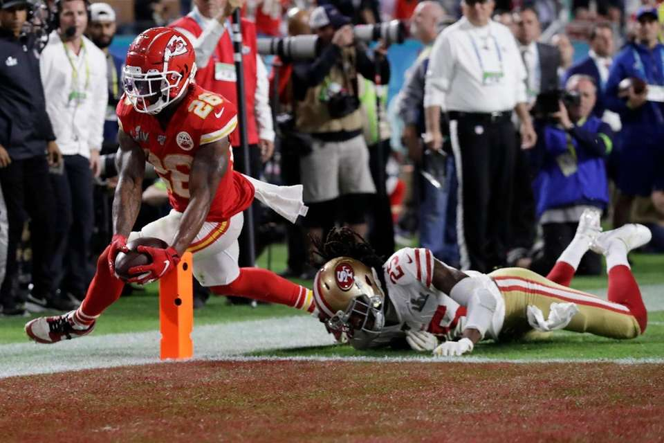Kansas City Chiefs' Damien Williams (26) scores a