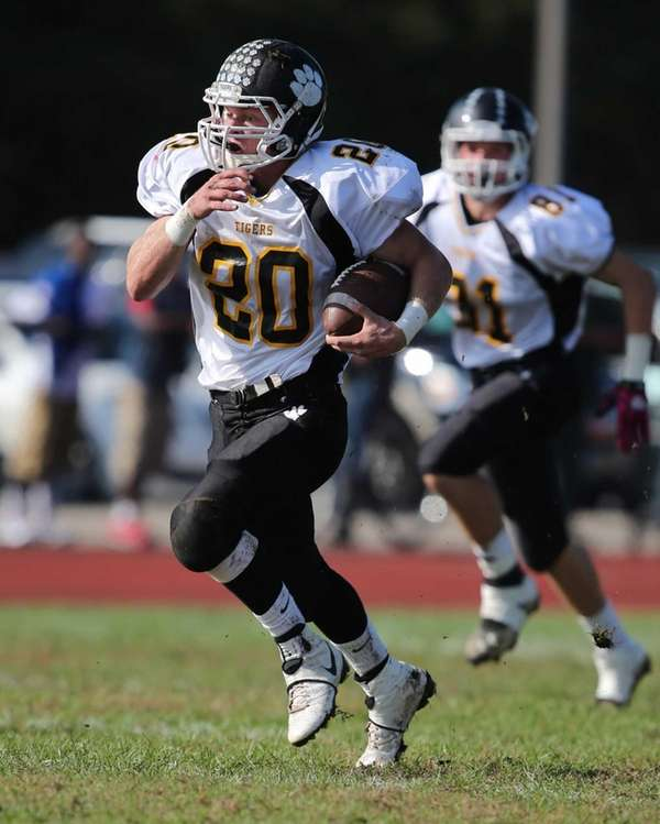 Northport running back John Trainer breaks through the