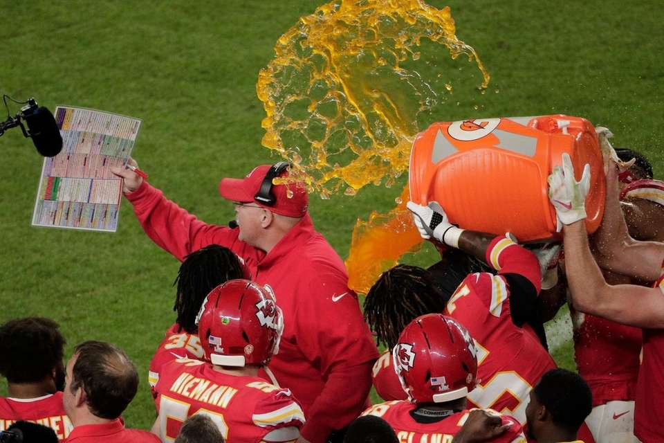 Kansas City Chiefs' players pour a cooler of