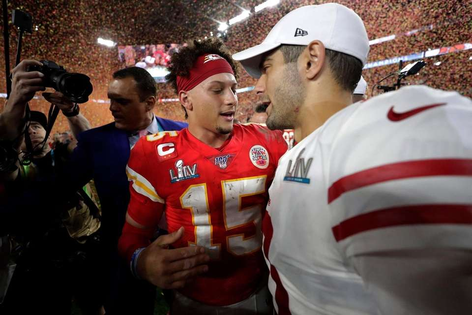 Kansas City Chiefs' quarterback Patrick Mahomes, left, speaks