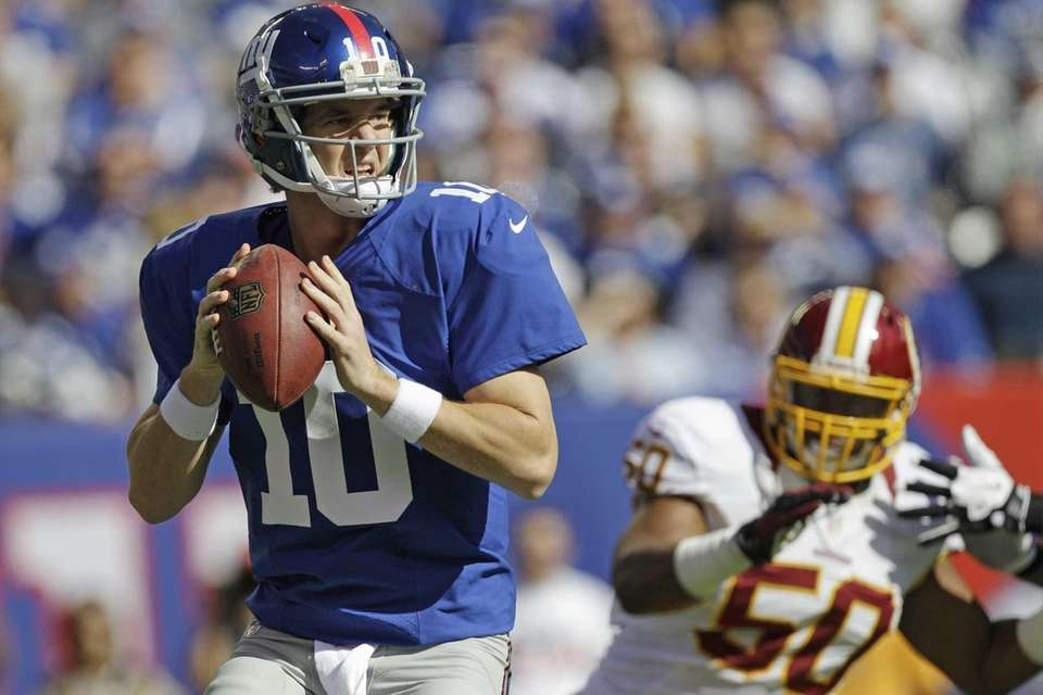 Giants quarterback Eli Manning looks to pass as