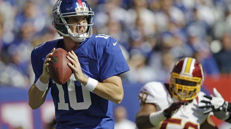 Giants quarterback Eli Manning looks to pass as
