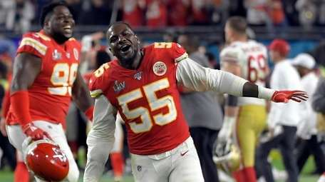 The Chiefs' Frank Clark celebrates after defeating the