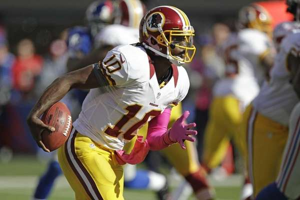 Washington Redskins quarterback Robert Griffin III rushes during