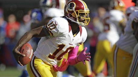 Washington Redskins quarterback Robert Griffin III rushes during