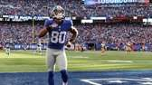 Victor Cruz celebrates after he scored during the