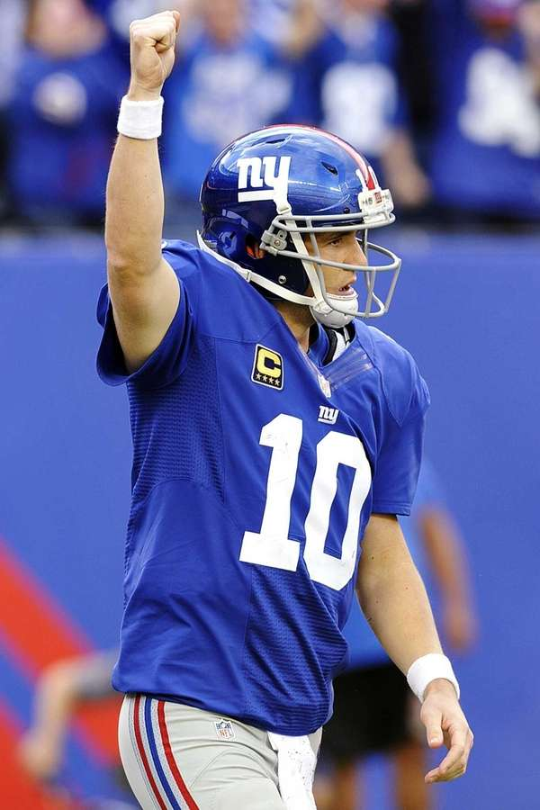 Eli Manning celebrates after throwing a touchdown pass