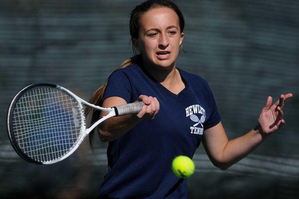 Hewlett senior Veronika Paikin returns a volley during