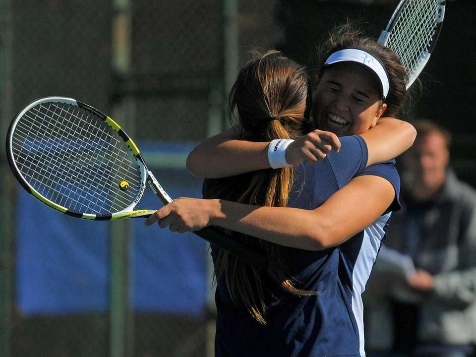 Hewlett senior Gabby Leon (wearing visor) and Veronika