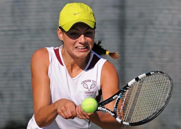 Garden City freshman Alexa Graham returns a volley