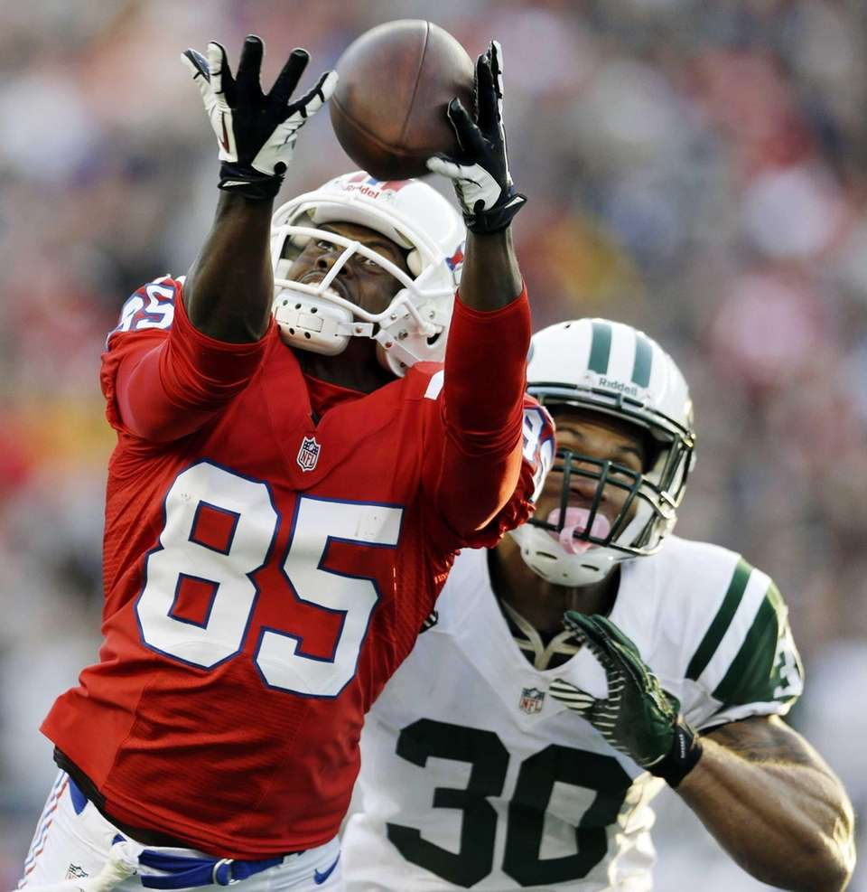 Patriots wide receiver Brandon Lloyd tries to catch