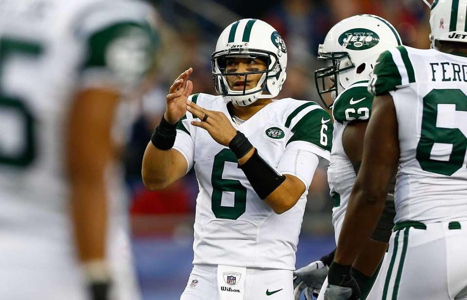 Mark Sanchez calls a timeout during a game