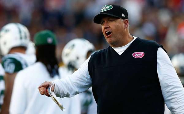 Head coach Rex Ryan talks with referees during