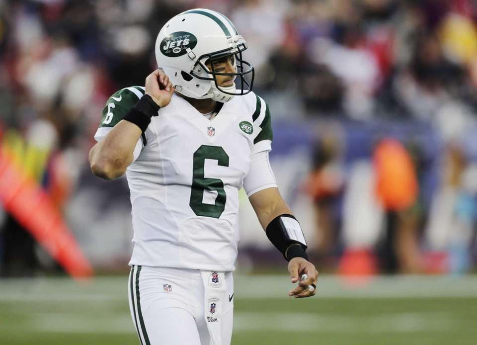 Jets quarterback Mark Sanchez walks off the field