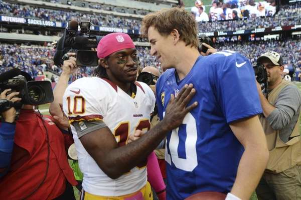 Washington Redskins quarterback Robert Griffin III greets Giants