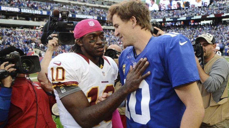 Washington Redskins quarterback Robert Griffin III greets Giants