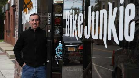 Doug Rodriguez owns Bike Junkie in downtown Bethpage.