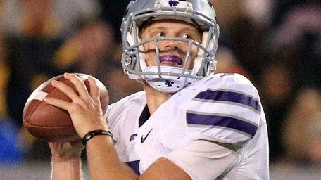 Kansas State quarterback Collin Klein looks to pass