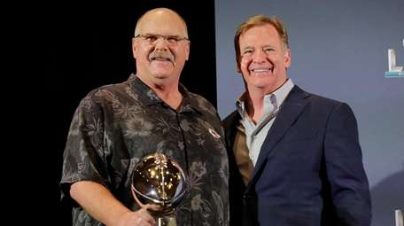 Kansas City Chiefs head coach Andy Reid holds