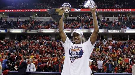 Indiana Fever forward Tamika Catchings celebrates with the