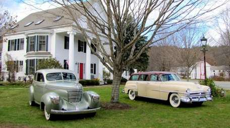 A 1939 Graham combination coupe, left, and a