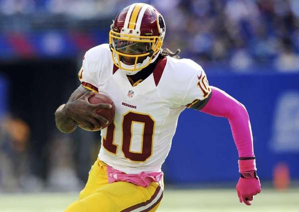 Washington Redskins quarterback Robert Griffin III carries the