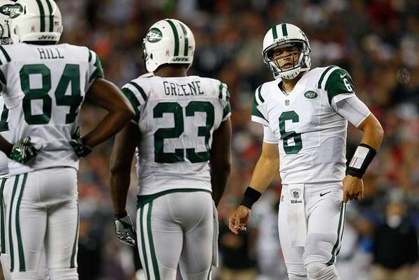 Mark Sanchez reacts in the huddle during the