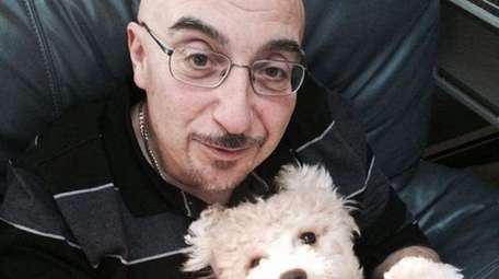 Israel Esquenazi and his dog, Leo, in 2017.