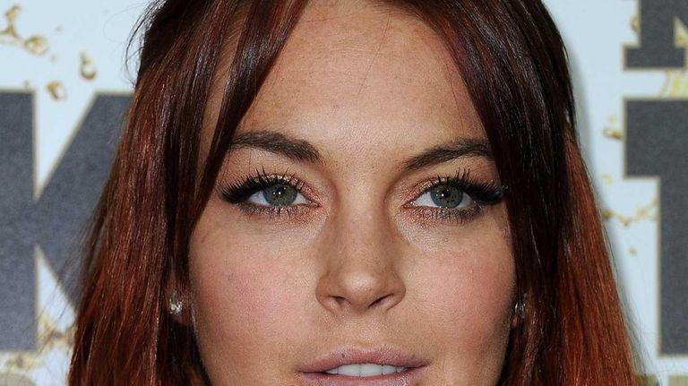 Lindsay Lohan arrives at the Mr. Pink Ginseng