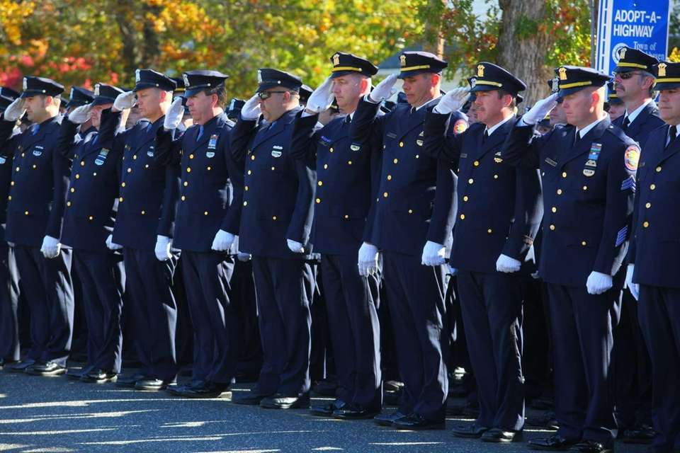 Ranks of police line Church Street for the