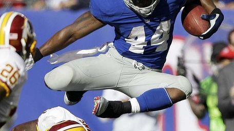 New York Giants running back Ahmad Bradshaw, top,