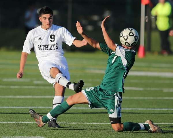Ward Melville's Anthony Passiatore clears the ball past