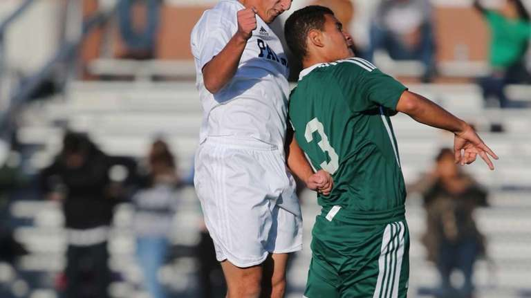 Ward Melville's Christian Mazzone heads the ball past