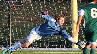 Ward Melville's goal keeper Jack Bruckner dives to