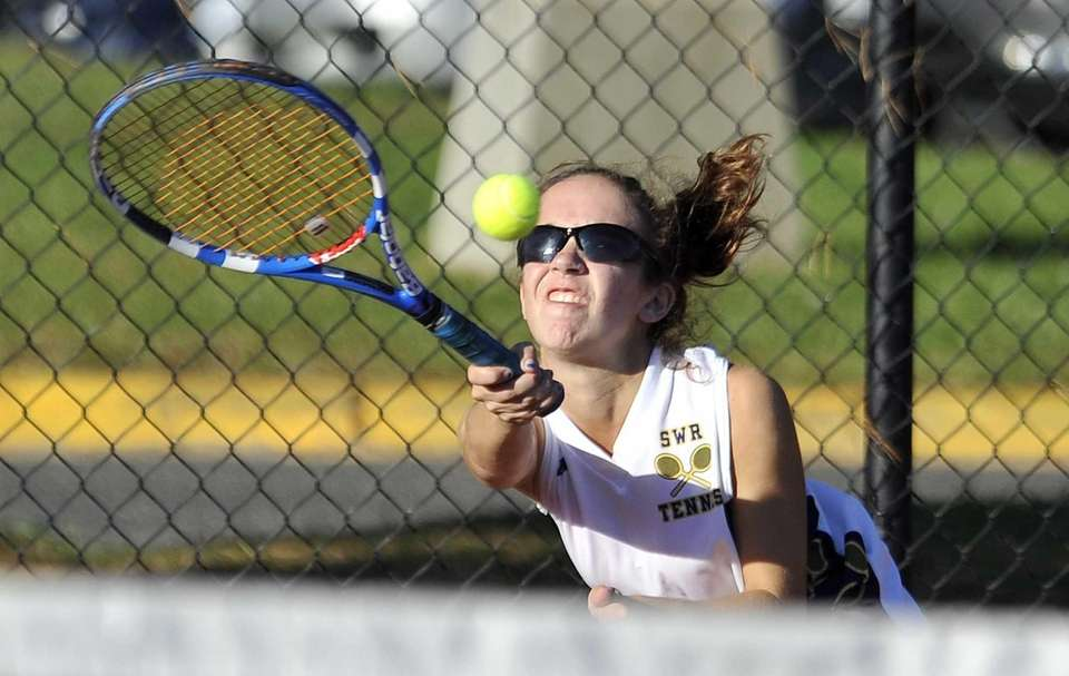 Aimee Manfredo of Shoreham-Wading River eyes the ball