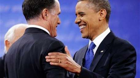 President Barack Obama, right, greets Republican presidential nominee