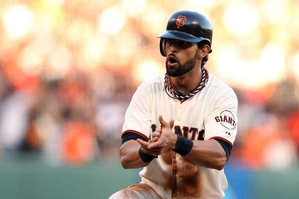 Angel Pagan reacts in the first inning of