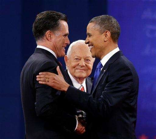 Moderator Bob Schieffer, center, watches as Republican presidential