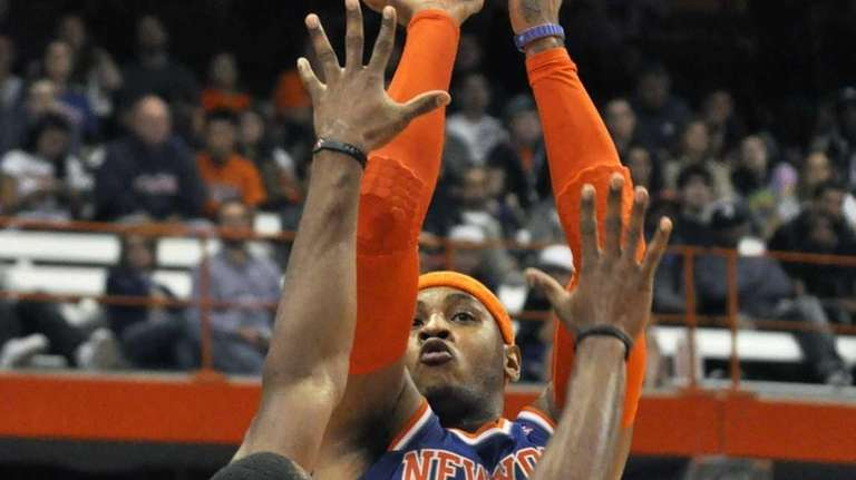 New York Knicks' Carmelo Anthony, right, shoots over