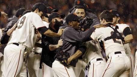 The San Francisco Giants celebrate after the final