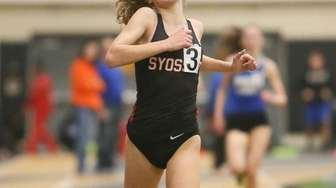 Syosset's Emily berg wins the 3000 meter run