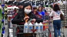 A shopper concerned about the global coronavirus outbreak