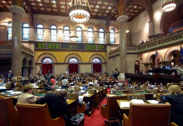 Members of the New York state Assembly hold