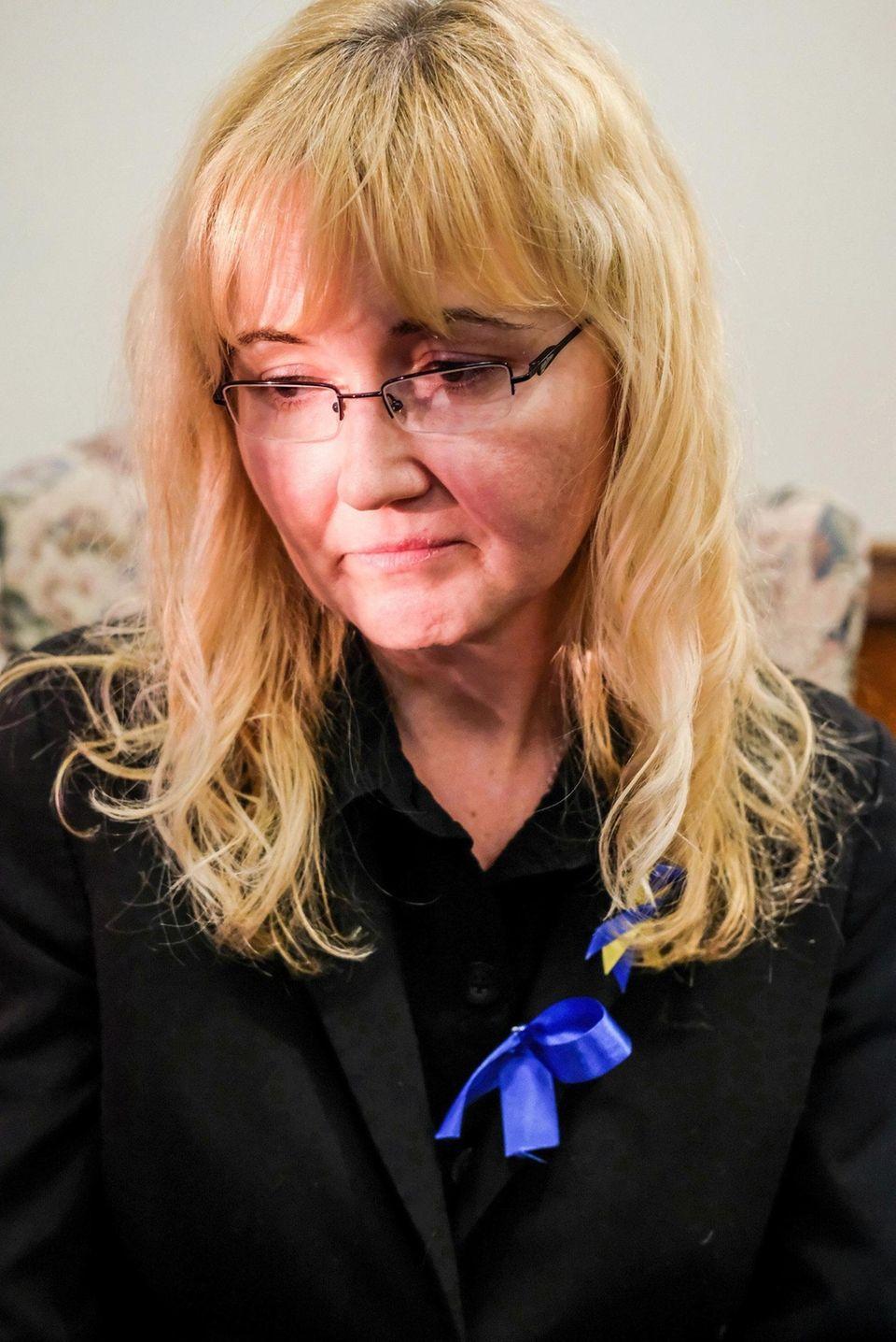 Justyna Zubko-Valva speaks during the wake for her