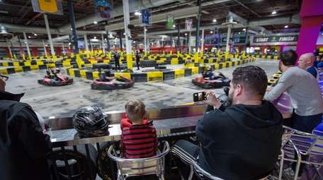 Viewers watch a race at RPM Raceway in