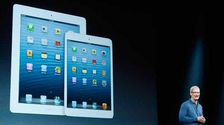 The new iPad mini, right, and fourth generation