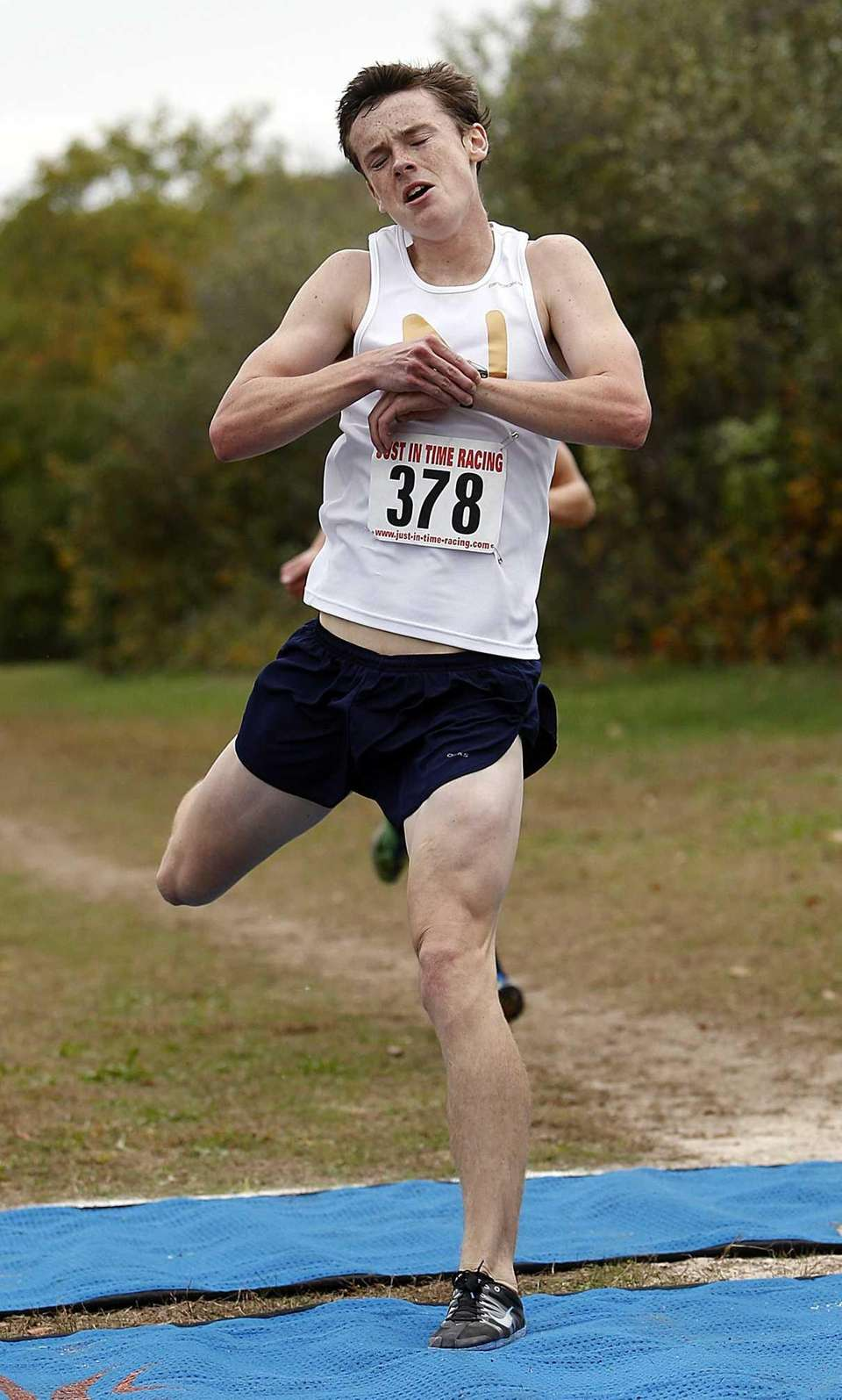 Northport's Mike Brannigan (378) crosses the finish line