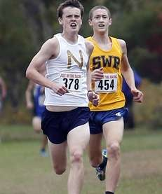 Northport's Mike Brannigan (378) stays just ahead of